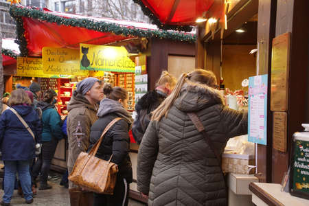 COLOGNE, GERMANY - DEC 17, 2018 - Sampling the food at the Christmas market,Cologne, Germany Stok Fotoğraf - 120454137