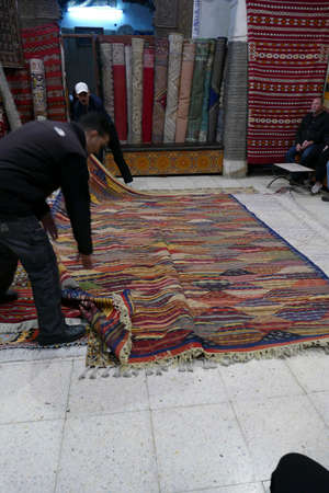 FES, MOROCCO - FEB 13, 2019 - Showing carpets in a shop in the medina of Fes, Morocco, Africa Editorial
