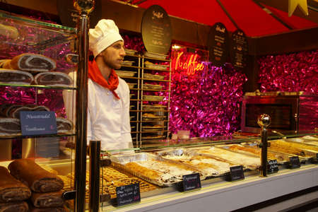 COLOGNE, GERMANY - DEC 17, 2018 - Sampling the food at the Christmas market,Cologne, Germany Stok Fotoğraf - 120454142
