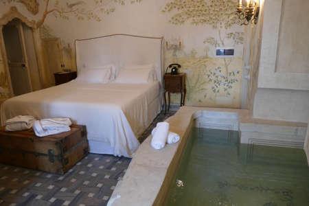LECCE, ITALY - APR 7, 2019 - Bedroom suite in a luxury hotel, Tenuta  Mose villa near Lecce, Puglia, Italy