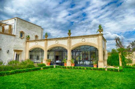 LECCE, ITALY - APR 6, 2019 - Exterior gardens of the Tenuta  Mose villa near Lecce, Puglia, Italy 에디토리얼