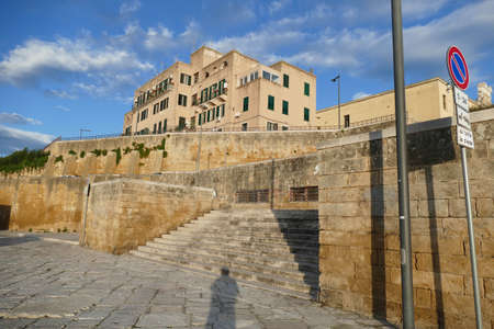 Waterfront fortification walls and buildings of Brindisi, Puglia, Italy Фото со стока