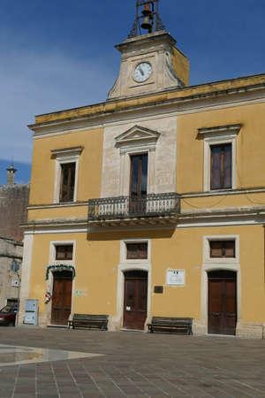 Ochre building in central square of Squalzino, Puglia, Italy
