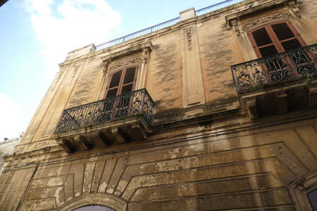 Baroque balconies on buildings in old part of Lecce, Puglia, Italy