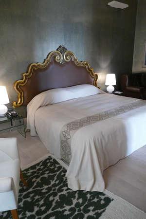 LECCE, ITALY - APR 7, 2019 - Bedroom suite in a luxury hotel, Risorgimento Resort, Lecce, Puglia, Italy