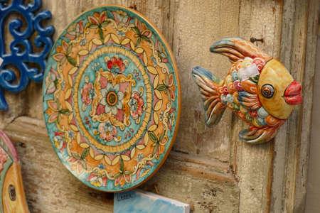 LECCE, ITALY - APR 6, 2019 - Traditional Italian designs on souvenir plates, Lecce, Puglia, Italy