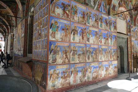 RILA, BULGARIA - APR 13, 2019 -Exterior fresco of guardian angel protecting against the temptations of demons, Rila orthodox monastery, Rila, Bulgaria Zdjęcie Seryjne