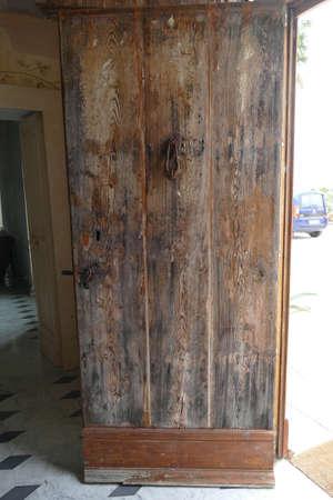 Old wooden door and iron handle, Tenuta  Mose villa near Lecce, Puglia, Italy