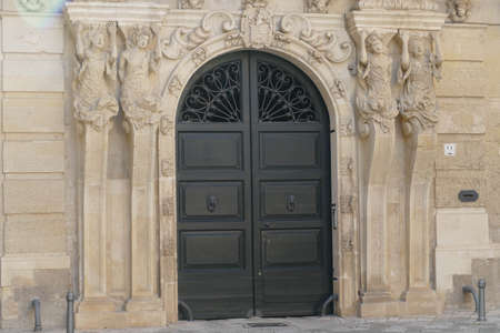 Caryatid columns support a palace entrance, Lecce, Puglia, Italy 스톡 콘텐츠
