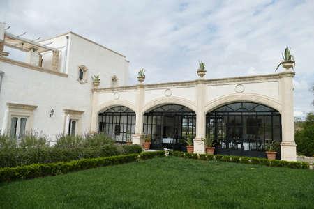 LECCE, ITALY - APR 7, 2019 - Exterior garden trellises of the Tenuta  Mose villa near Lecce, Puglia, Italy
