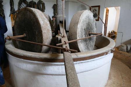 LECCE, ITALY - APR 9, 2019 - Vintage olive oil mill and grindstone, Antica Masseria Brancati,Lecce, Puglia, Italy
