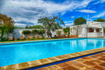BRINDISI, ITALY - APR 11 2019 - Outside infinity swimming pool in a luxury villa hotel near Brindisi, Puglia, Italy