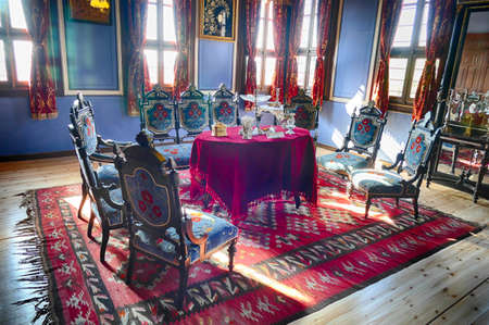 PLOVDIV, BULGARIA - APR 17, 2019 - Table and chairs from 19th century middle class home, Ethnographic Museum, Plovdiv, Bulgaria