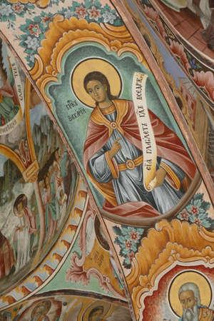 RILA, BULGARIA - APR 13, 2019 - Exterior fresco paintings of saints, Rila orthodox monastery, Rila, Bulgaria