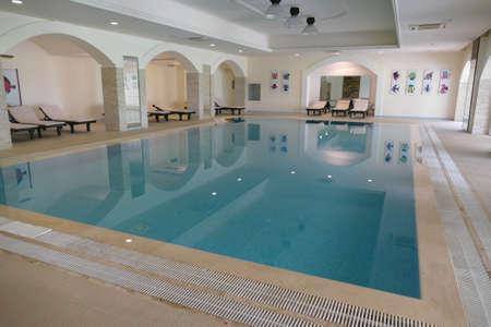 BRINDISI, ITALY - APR 11 2019 - Indoor swimming pool in a luxury villa hotel near Brindisi, Puglia, Italy