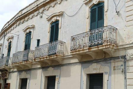 Iron balconies in narrow streets of Gallipoli, Puglia, Italy