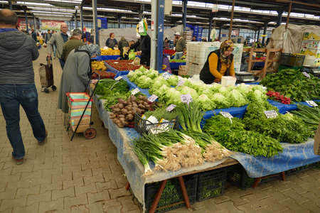 CANAKKALE, TURKEY - APR 21, 2019 -Buying vegetables in the central market of Canakkale, Turkey Redactioneel