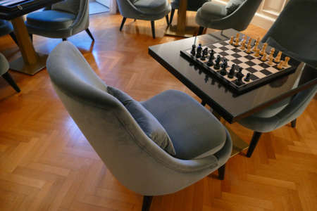 LECCE, ITALY - APR 6, 2019 - Chess table in a luxury hotel study, La Fiermontina Hotel, Lecce, Puglia, Italy
