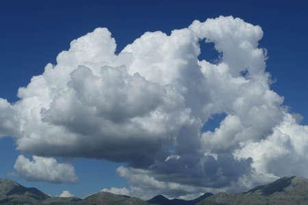 Cumulus clouds building along the  Croatia coast, Adriatic Sea