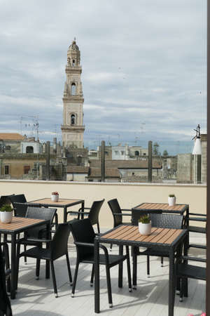 LECCE, ITALY - APR 7, 2019 - View of bell tower from rooftop terrace of luxury hotel, Risorgimento Resort, Lecce, Puglia, Italy Standard-Bild - 122236193