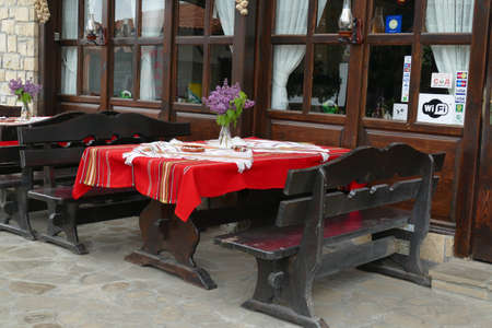 Outdoor restaurant with red tables, Arbanasi, Bulgaria Editorial