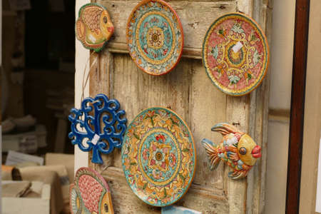 LECCE, ITALY - APR 6, 2019 - Traditional Italian designs on souvenir plates, Lecce, Puglia, Italy
