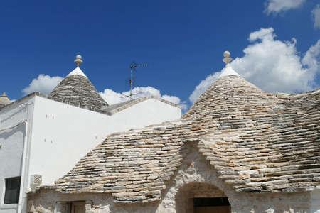 Stone coned rooves of trulli houses in Alberobello, Puglia, Italy