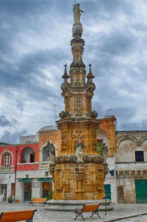 Baroque water fountain tower in Nardo, Puglia, Italy 스톡 콘텐츠