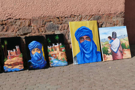 MARRAKECH, MOROCCO - FEB 19, 2019 - Paintings of Tuareq desert people, Djemma el Fna, Marrakech,  Morocco, Africa Editorial