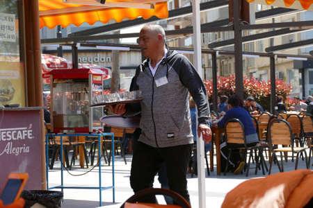 CANAKKALE, TURKEY - APR 21, 2019 -Serving tea in an outdoor restaurant in  Canakkale, Turkey
