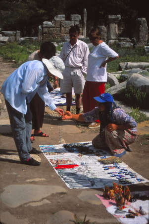 CAPPADOCIA, TURKEY - APR 14, 2001 - Tourist bargaining for souvenirs in Cappadoccia, Turkey