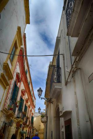 Narrow street of Gallipoli, Puglia, Italy Stock Photo