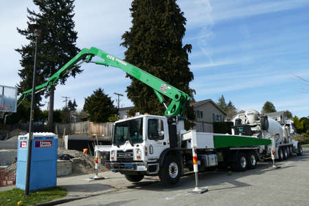SEATTLE - APR 1, 2019 - Truck with crane working on new residential construction. Seattle, Washington Editorial