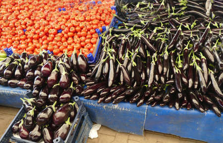 Bright red tomatoes and eggplant in the central market of Canakkale, Turkey