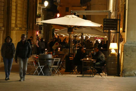 LECCE, ITALY - APR 6, 2019 - Evening diners at outdoor tables, Lecce, Puglia, Italy