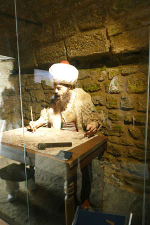 KALITBAHIR, TURKEY - APR 21, 2019 - Piri Reis cartographer drawing a map, Kalitbahir, Turkey Editorial