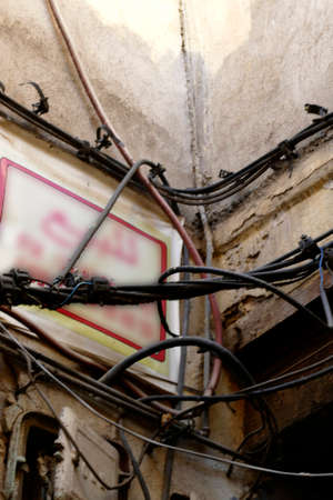 Tangle of electrical wires and connections in the medina of Fes, Morocco, Africa