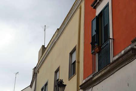 Backlit pastel buildngs under a stormy sky, Nardo, Puglia, Italy Stock Photo