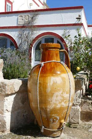 ALBEROBELLO, ITALY - APR 10, 2019 - Large ochre amphora urns in Masseria Montenapoleone, near Alberobello, Puglia, Italy