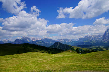Green valley and meadows in the Dolomite alps near Castelrotto - Kastelruth, Italy