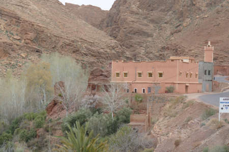Small village of mud brick houses in the mountain valley near Ouarzazate,  Morocco, Africa Standard-Bild - 123706603
