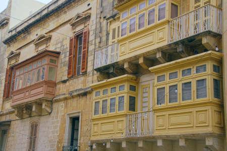 Vintage balconies on narrow street of Valletta, Malta Reklamní fotografie
