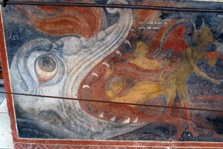 RILA, BULGARIA - APR 13, 2019 - Exterior fresco paintings of sinners condemned to hell, Rila orthodox monastery, Rila, Bulgaria