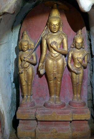 BAGAN, MYANMAR - FEB 25, 2015 - Buddhist statues inset in alcove of the Ananda Phaya Temple, Bagan,  Myanmar (Burma)