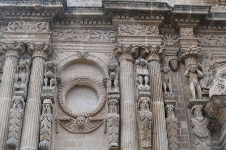 Baroque carvings on the exterior columns of the Church of San Domenico, Nardo, Puglia, Italy