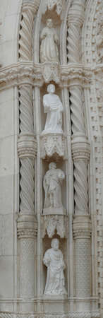 Statues surrounding the massive doors of the Cathedral of St. JamesSibenik, Croatia