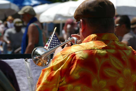 PORTLAND, OREGON - JUL 4, 2019 - Trumpet player entertains the crowd at the Waterfront Blues Festival, Portland, Oregon