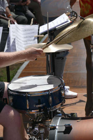 Percussionist plays the drums at the Waterfront Blues Festival, Portland, Oregon