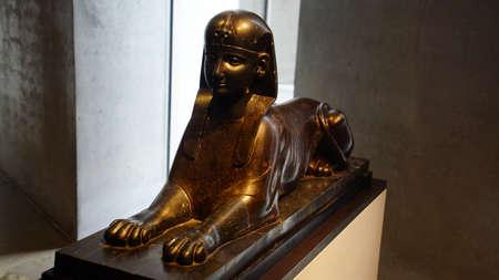 MUNICH - JUL 21, 2018 - Seated sphinx statue, Egyptian Museum, Munich, Germany Редакционное