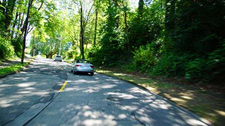 Light traffic on residential street in Seattle, Washington Imagens